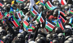 South Sudanese citizens wave their flags as they attend the Independence Day celebrations in the capital Juba